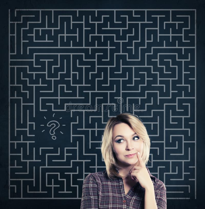 Thinking Woman with Labyrinth Background stock photos