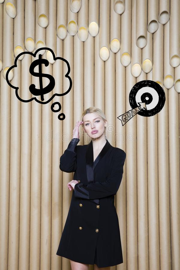 Thinking woman looking up on money sign in bubble and sketch target. Money concept on design background with lamps. Thinking blond woman looking up on money royalty free stock photos