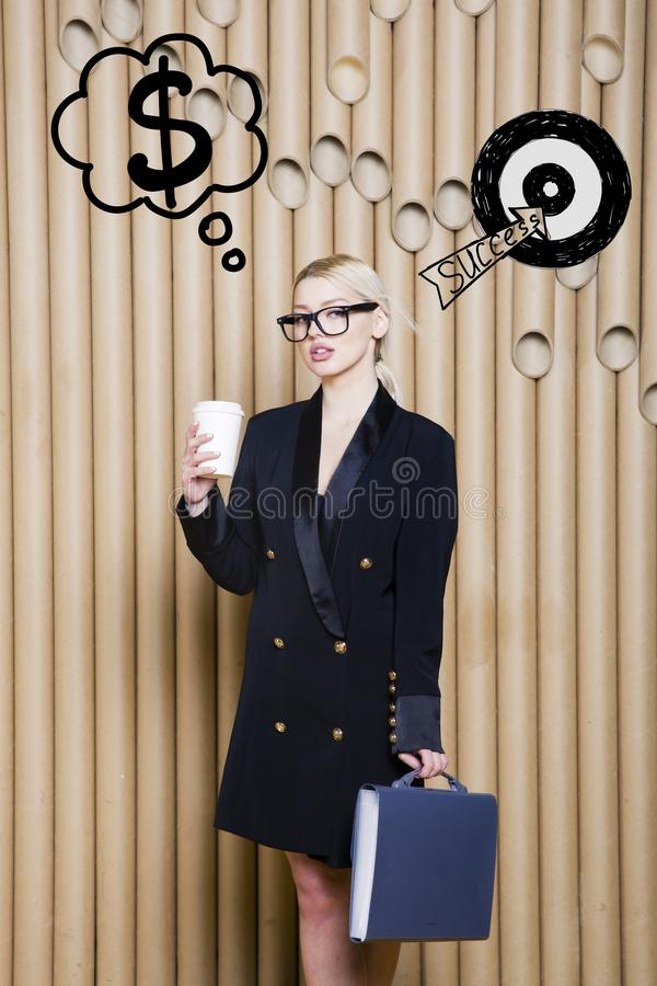 Thinking woman looking up on money sign in bubble and sketch target. Money concept on design background with lamps. Thinking blond woman looking up on money stock photo