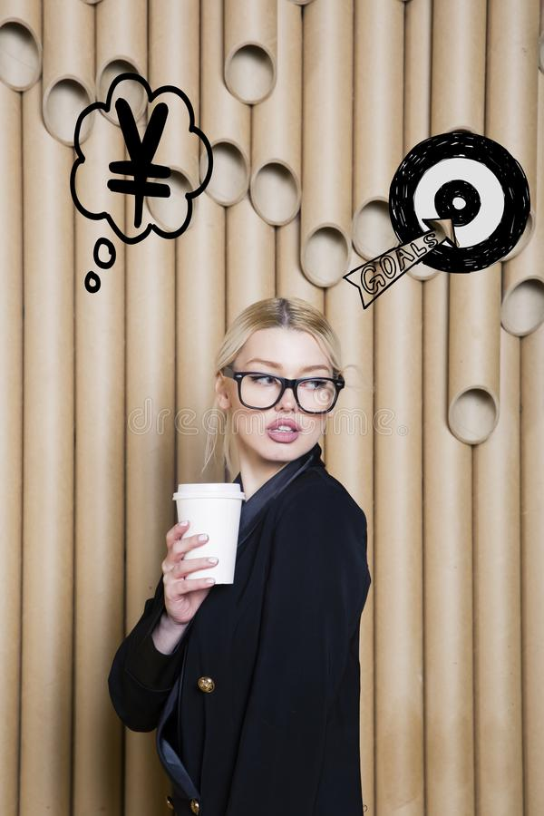 Thinking woman looking up on money sign in bubble and sketch target. Money concept on design background with lamps. Thinking blond woman looking up on money royalty free stock images