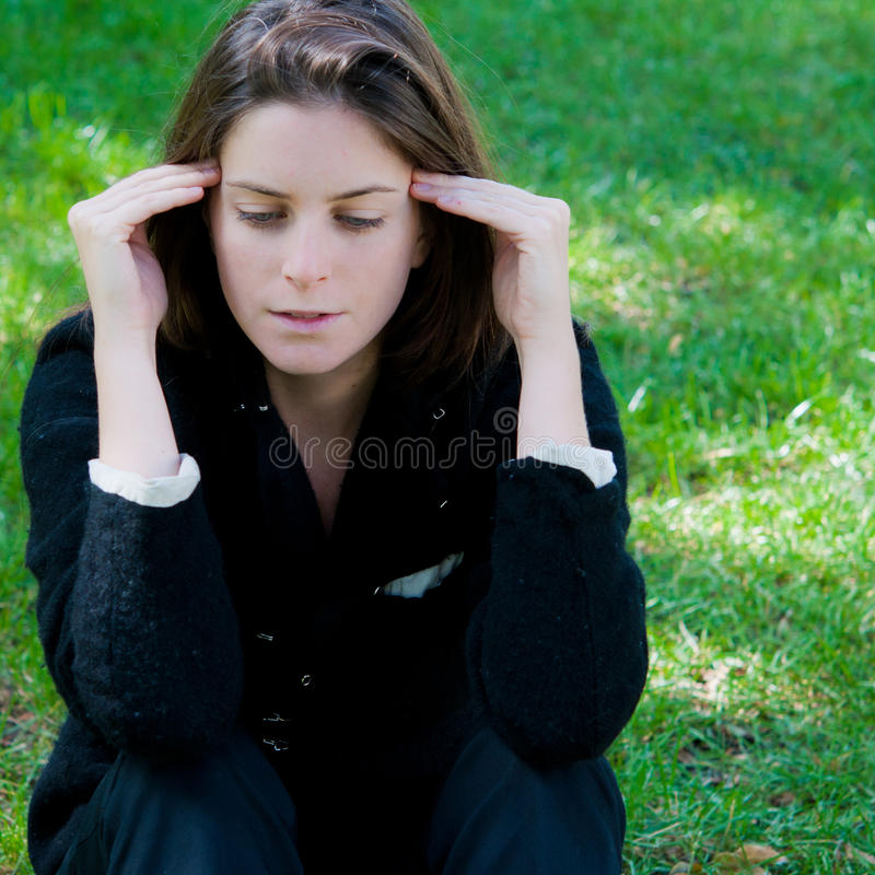 Thinking woman on the nature