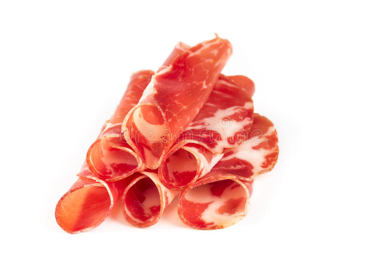 Thinly sliced ​​ham. Isolated on white background stock photography