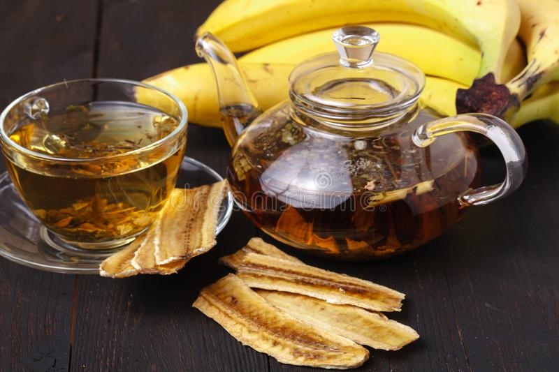 Thinly sliced banana chips, a tropical snack with tea stock photo