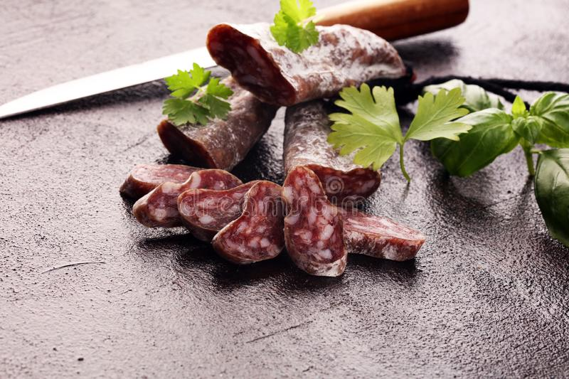 Salami cut. thinly sliced salami on a wooden texture on the background royalty free stock images