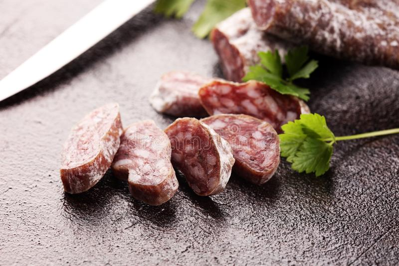 Salami cut. thinly sliced salami on a wooden texture on the background stock image