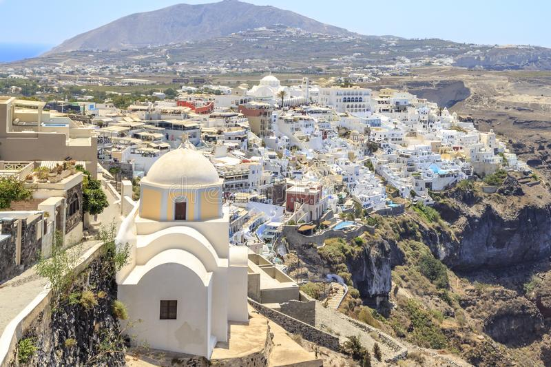 Thira town with St. Stylianos church during daytime in Santorini, Greece. Thira town with St. Stylianos church during daytime in Santorini island, Greece stock photos