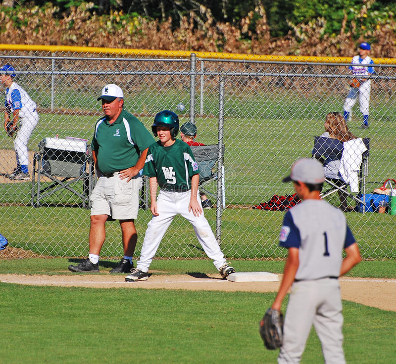 Download Third Base Coach. With Boy On Base. Editorial Stock Image - Image: 19615334