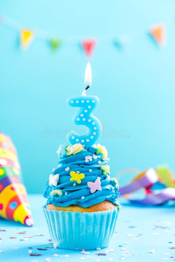 Third 3rd birthday cupcake with candle. Card mockup. stock image