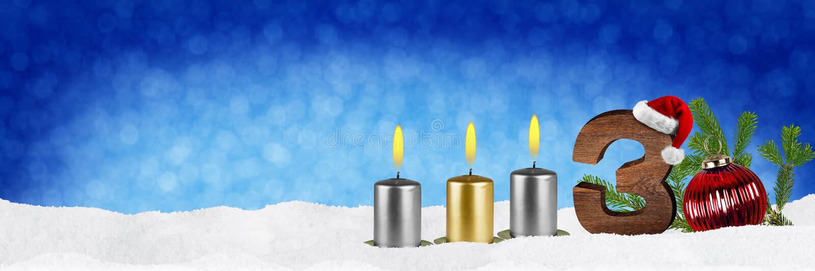 Third sunday of advent. Concept xmas panorama blue background with candles ball bauble snow and red silver decorated fir branches stock photography