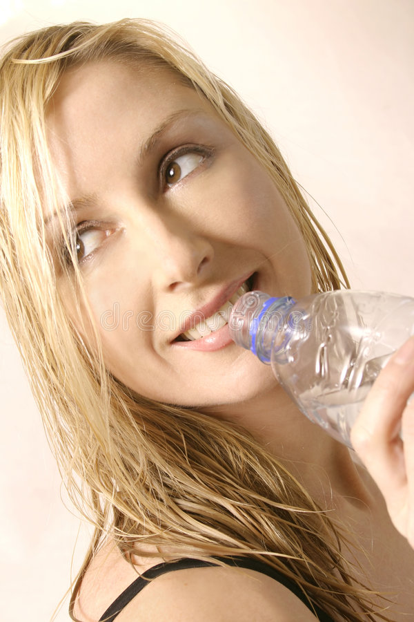 Thirst Quencher. Woman with a water bottle stock photos