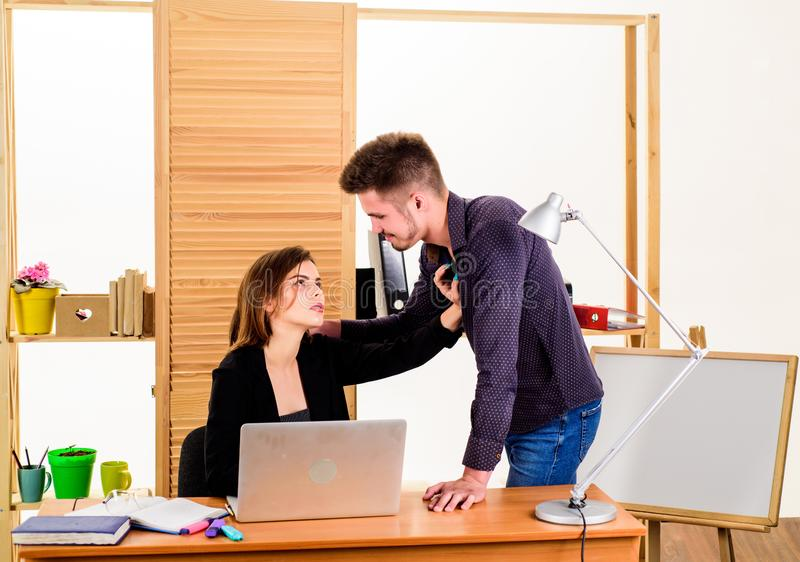 A thirst for romance. Couple of young coworkers conducting office romance. Workplace romance of handsome man and sexy. A thirst for romance. Couple of young stock photos