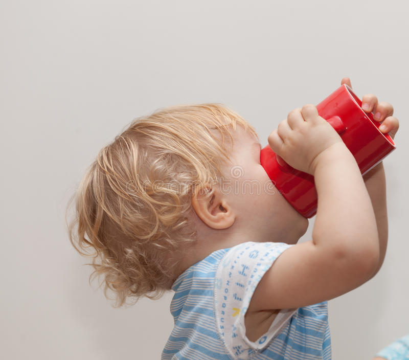 Thirsty baby royalty free stock images