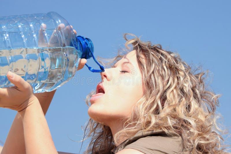 Thirsty blond woman on desert royalty free stock photo