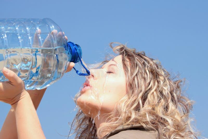 Thirsty blond woman on desert stock photo