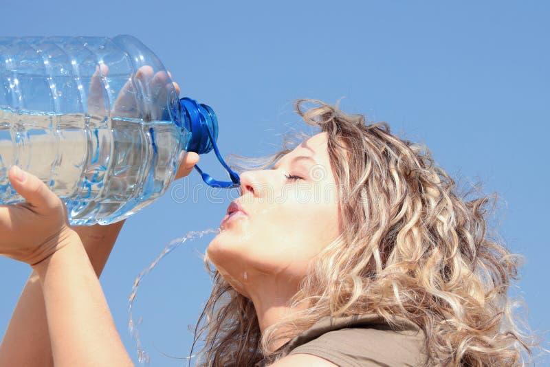 Thirsty blond woman on desert stock image