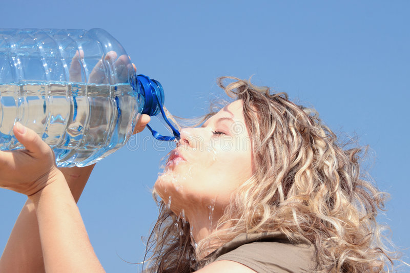 Thirsty blond woman on desert royalty free stock image