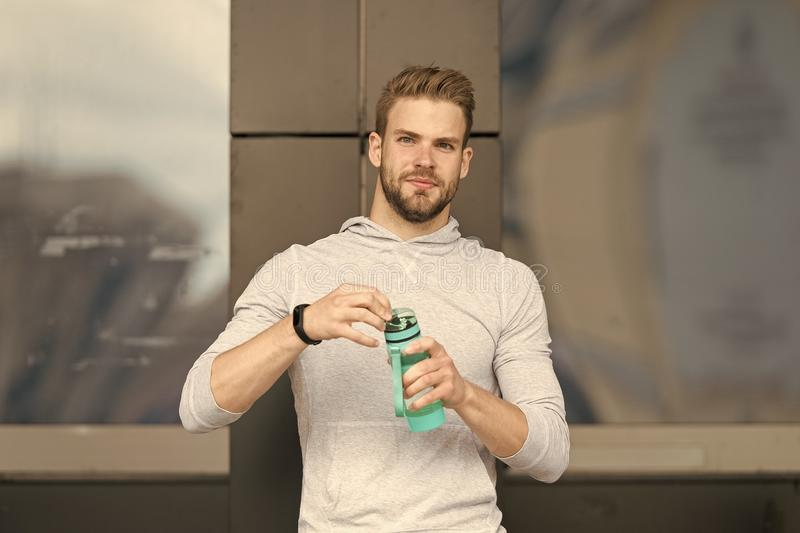 Thirsty concept. Young guy look thirsty. Thirsty man hold water bottle. A drop of water is life for a thirsty person.  royalty free stock image