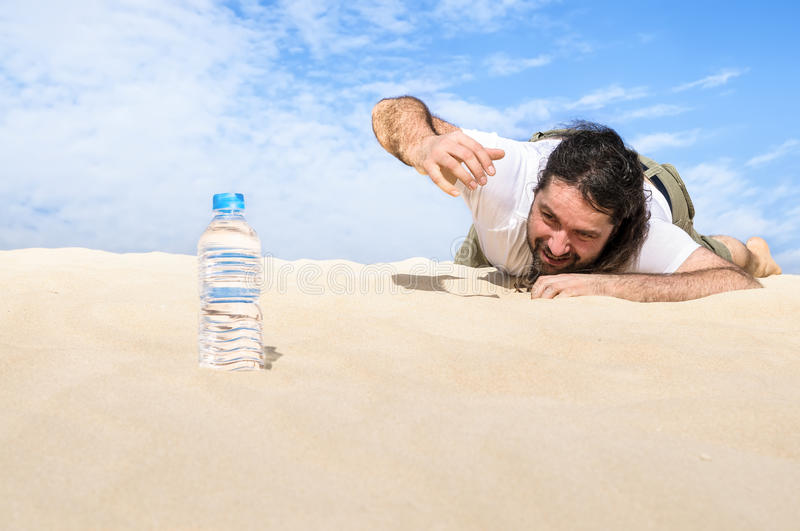 Thirsty Man In The Desert Reaches For A Bottle Of Water ...