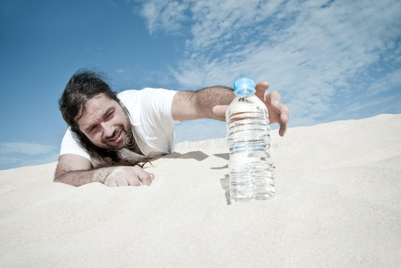Thirsty man reaches for a bottle of water royalty free stock image