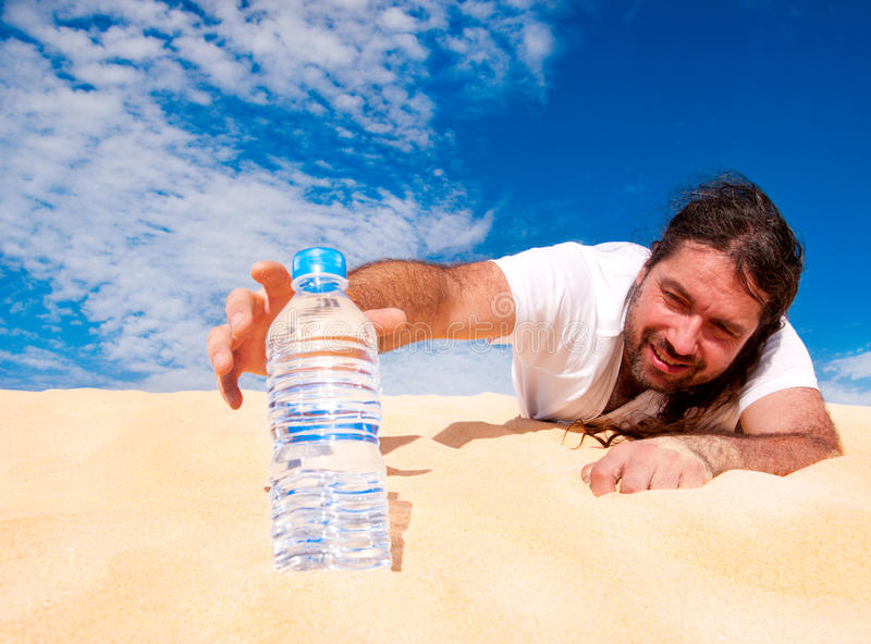 Thirsty man reaching for a bottle of water royalty free stock image