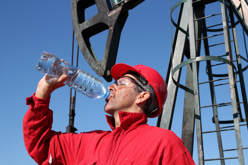 Thirsty Oil Industry Worker. stock photo