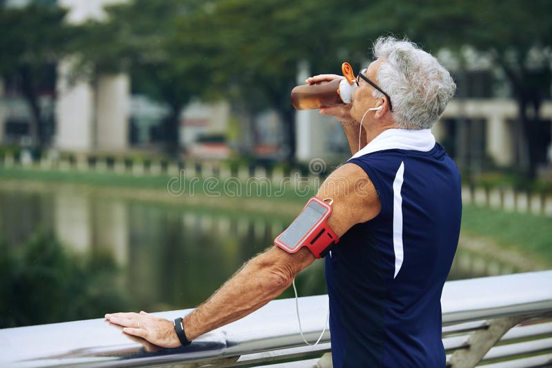 Thirsty sportsman stock photos