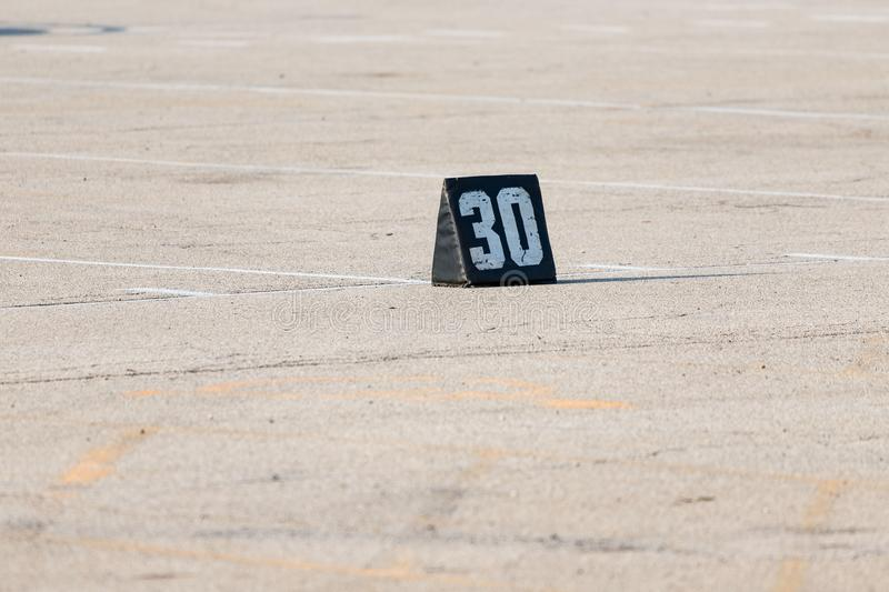 Thirty yard line marker ready for rehearsal at band camp stock photography