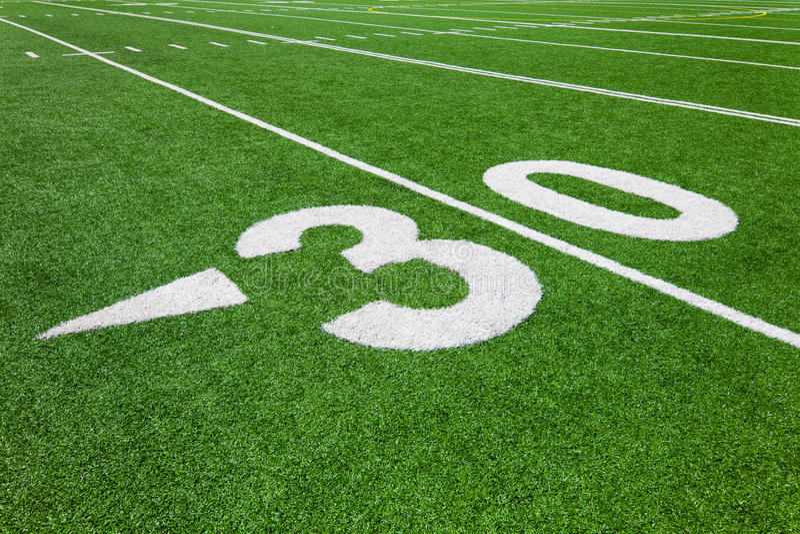 Thirty yard line - football stock photo