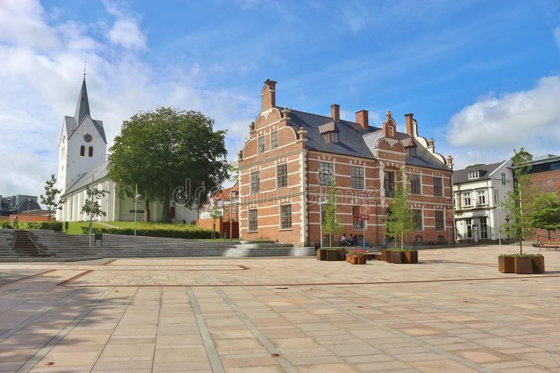 Thisted in Denmark, Europe. THISTED, DENMARK - JULY 9, 2016: Town hall and church of Thisted at Limfjord, Jutland, Denmark.THISTED, DENMARK - JULY 9, 2016: Town stock photos