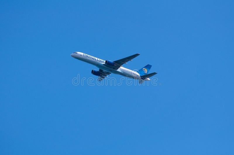 Thomas Cook Jet Against Blue Sky royalty free stock photos