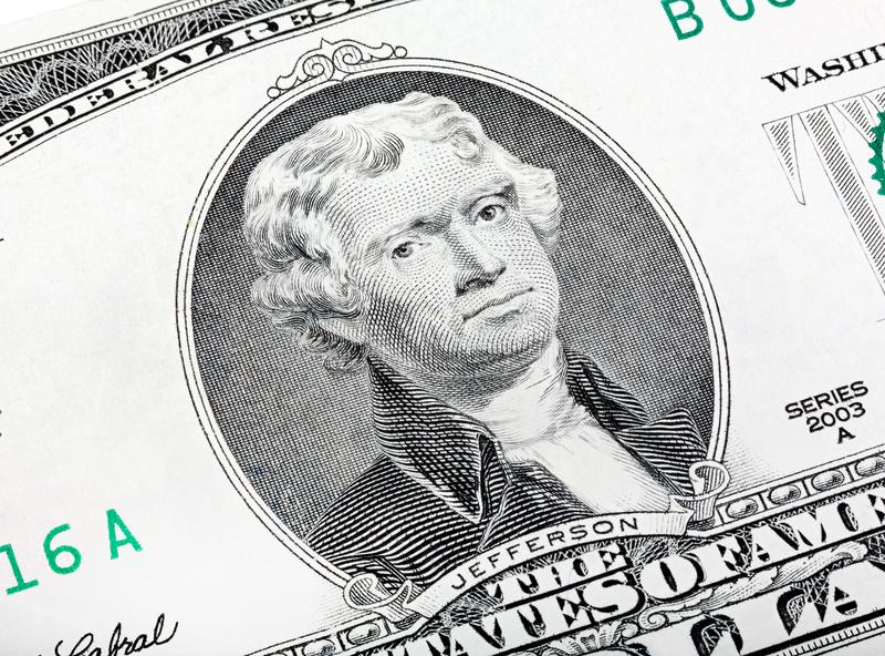 Thomas Jefferson Portrait qualitatif de 2 billet d'un dollar chanceux image stock