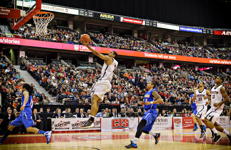 Men's CIS Basketball Finals. Thomas Scrubb (centre) in action for the Carleton Ravens in their match against Lakehead Thunderwolves at Scotiabank Place, Ottawa royalty free stock images