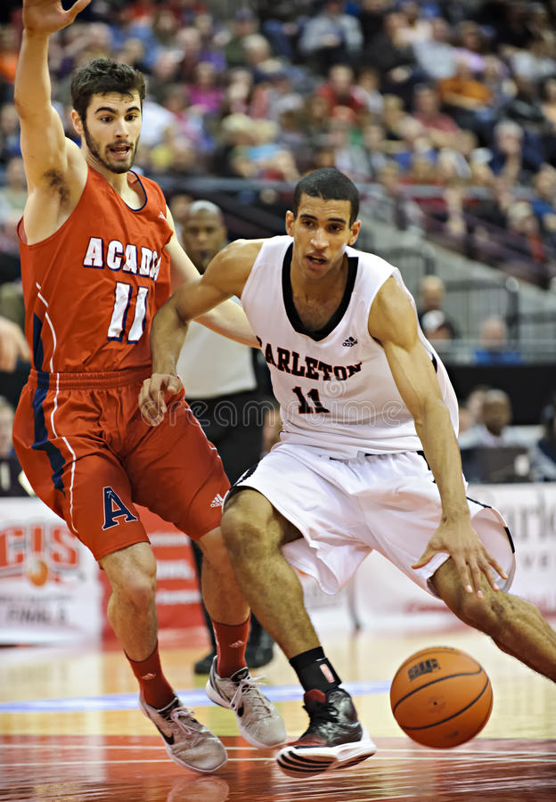 Men's CIS Basketball Finals. Thomas Scrubb (right) in action for the Carleton Ravens in their match against Acadia Axemen at Scotiabank Place, Ottawa on March 9 stock photo