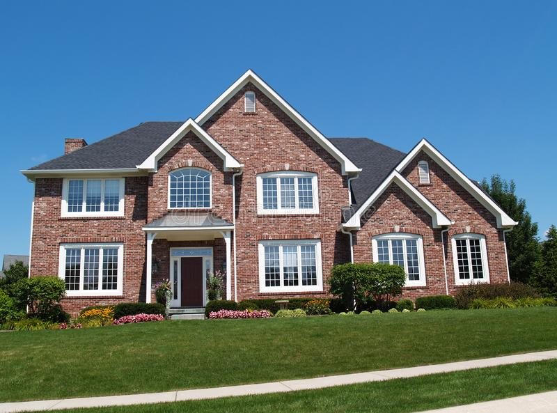 Large Two Story Brick Residential Home royalty free stock image
