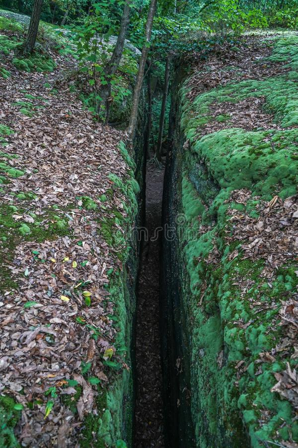 Squeeze Through the Crack in the Ground royalty free stock photo