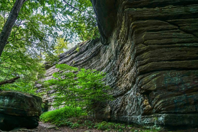 Squeeze Through the Crack in the Ground. This is Thompson Ledges in northeast Ohio you squeeze through the crack in the ground and it opens up to a beautiful royalty free stock photos