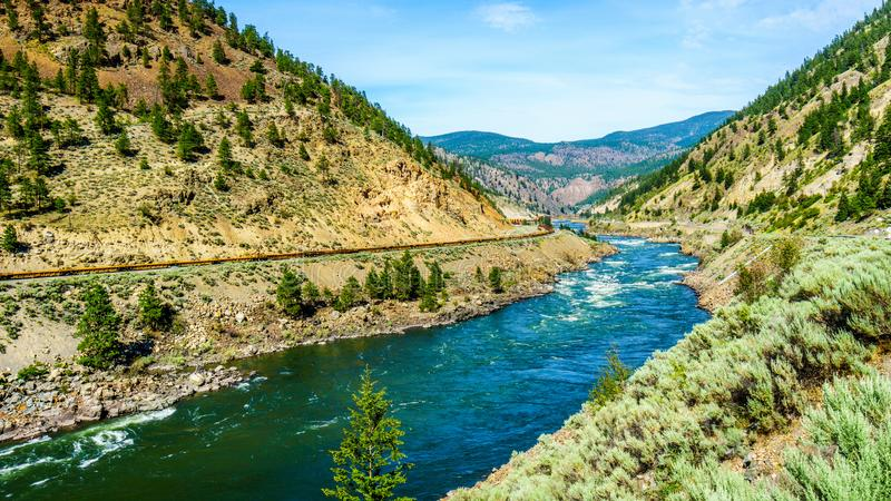 Thompson River with its many rapids flowing through the Canyon in the Coastal Mountain Ranges of British Columbia royalty free stock photo