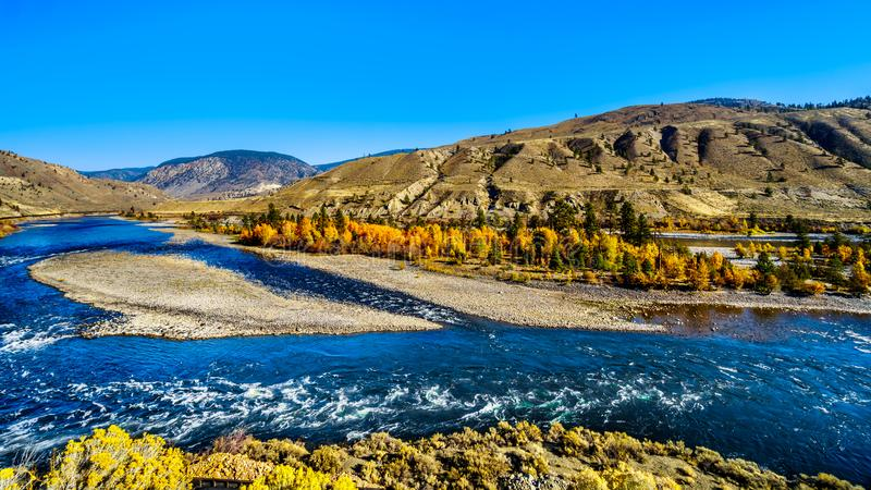 The Thompson River at Spences Bridge in BC Canada. Fall colors surrounding the Thompson River, North of the town of Spences Bridge on the Fraser Canyon route of royalty free stock photo