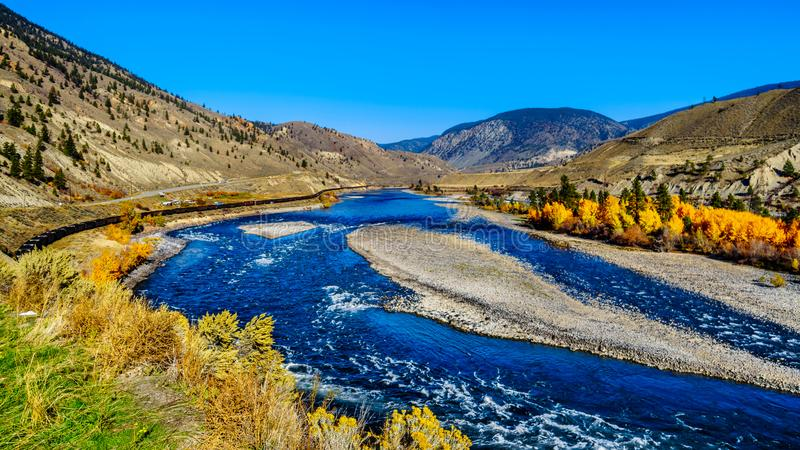 The Thompson River at Spences Bridge in BC Canada. Fall colors surrounding the Thompson River, North of the town of Spences Bridge on the Fraser Canyon route of stock photography