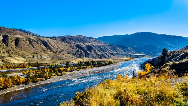 The Thompson River at Spences Bridge in BC Canada. Fall colors surrounding the Thompson River, North of the town of Spences Bridge on the Fraser Canyon route of stock photo