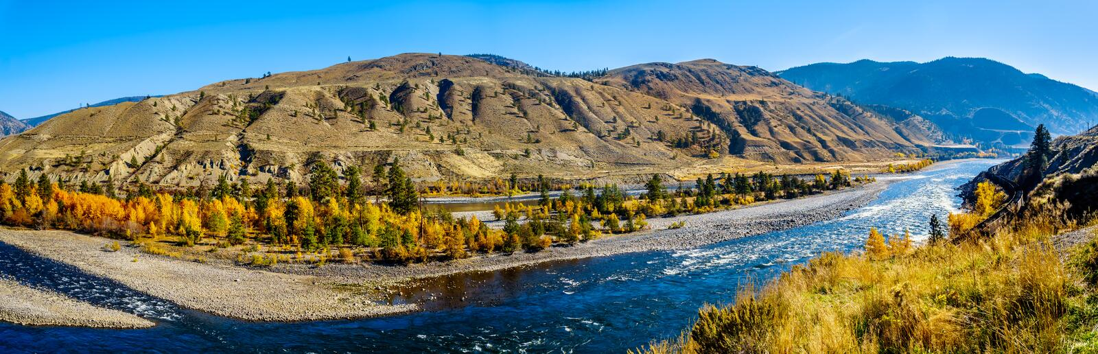 The Thompson River at Spences Bridge in BC Canada. Fall colors surrounding the Thompson River, North of the town of Spences Bridge on the Fraser Canyon route of royalty free stock photography