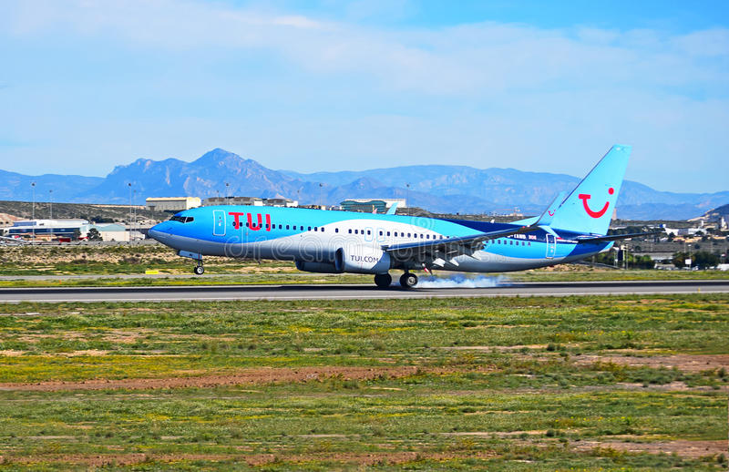 Thompsons TUI Passenger Plane Smokes The Tyres While Landing. A Thompsons Holiday flight smoking the tyres as it touches down at Alicante Airport royalty free stock image