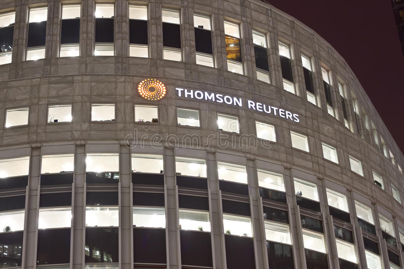 Thomson Reuters. Logo and firm on a Canary Wharf office building in London, UK stock photos