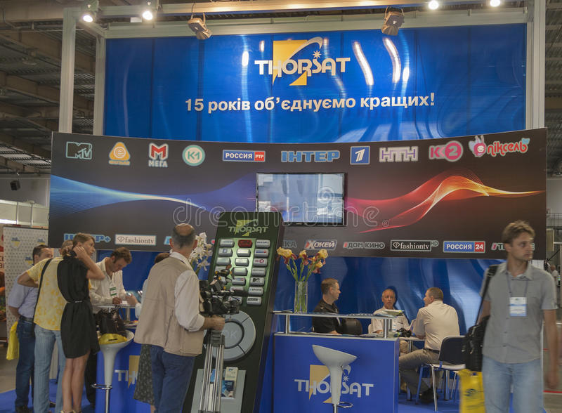 Thorsat TV satellite provider company booth. Visitors visit Thorsat TV satellite provider company booth at Kyiv International TV and Radio Fair 2013 in Kiev stock images