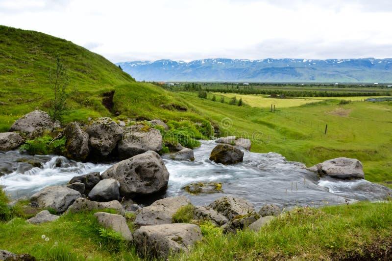 Thorsteinslundur waterfall in motion blur on overcast summer da royalty free stock photography