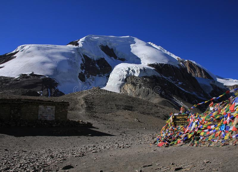 Thorung La mountain pass and glacier. Scenery on top of the Thorung La mountain pass, Annapurna Conservation Area, Nepal. Mountain covered by glacier. Prayer royalty free stock photography