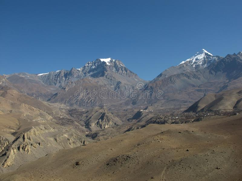 Thorung La Pass. Village Muktinath 3760 m altitude. High mountains Yakwakang and Khatungkang stock photography