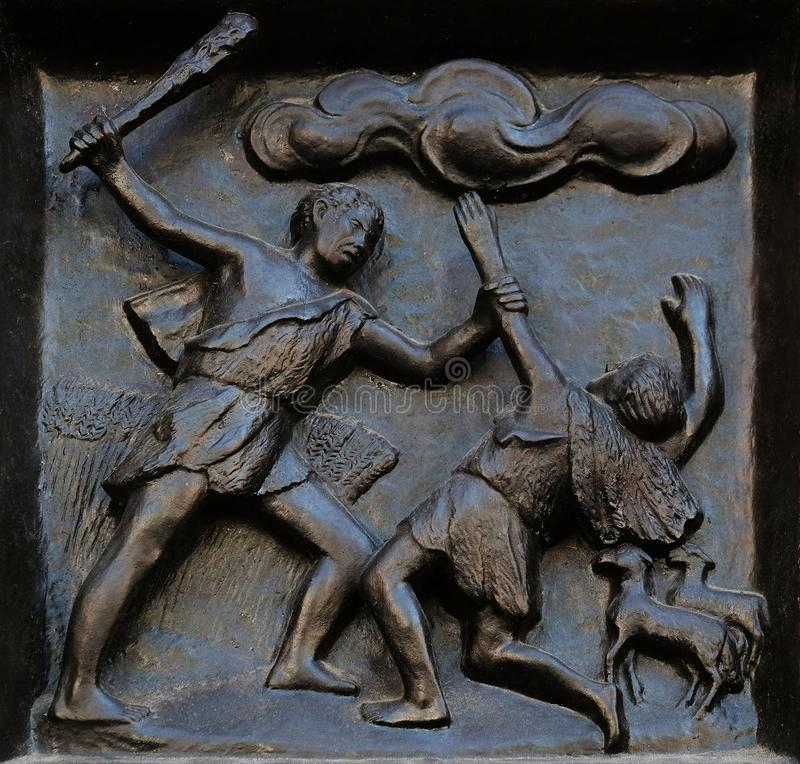 Thou shalt not kill - Cain and Abel, relief on the door of the Grossmunster church in Zurich stock images