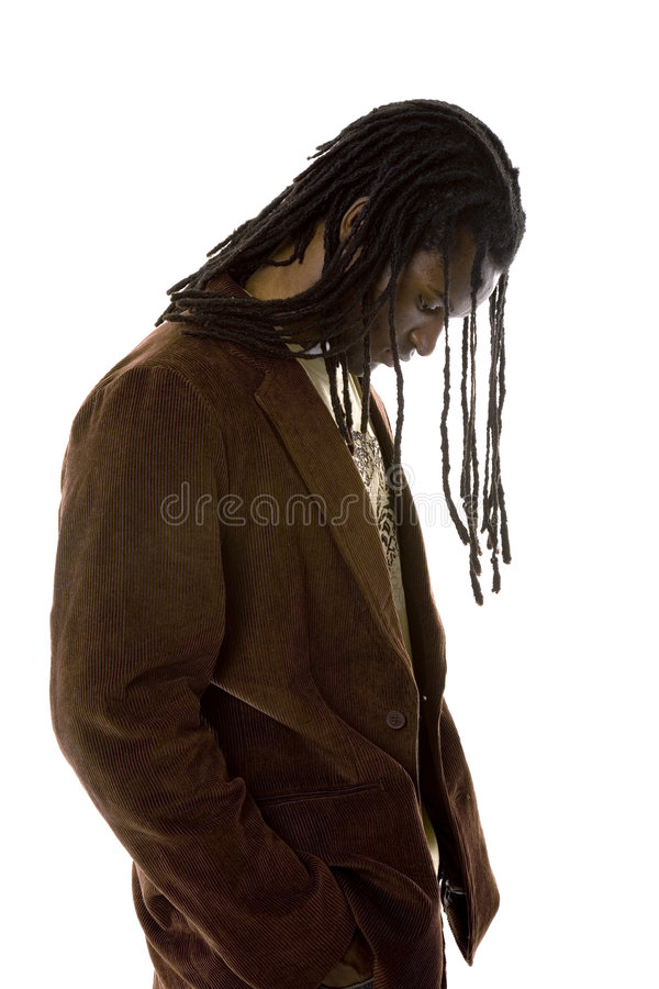 In thought. African American male looks down as if in deep thought stock photography
