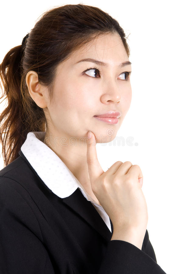 Thought. Young Asian business women having a thought royalty free stock images